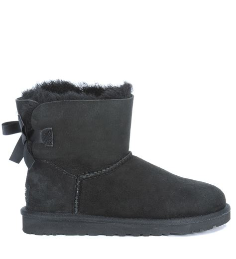 ugg mini bailey bow black ankle boots in black nero lyst