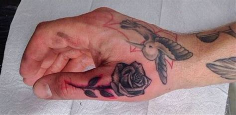 rose tattoo on finger 33 beautiful finger tattoos
