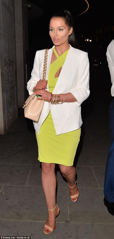Helen Halter Neck Dress helen flanagan covers up hourglass figure by wearing a lime green halterneck dress with a
