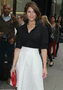 gemma arterton looks tanned in a black shirt and a line