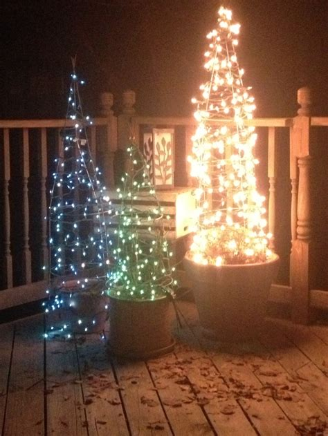 how to wrap christmas lights around a tree 19 best tomato cage ideas images on pinterest christmas