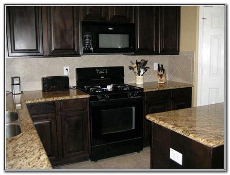 dark wood cabinets  black appliances odguinz home