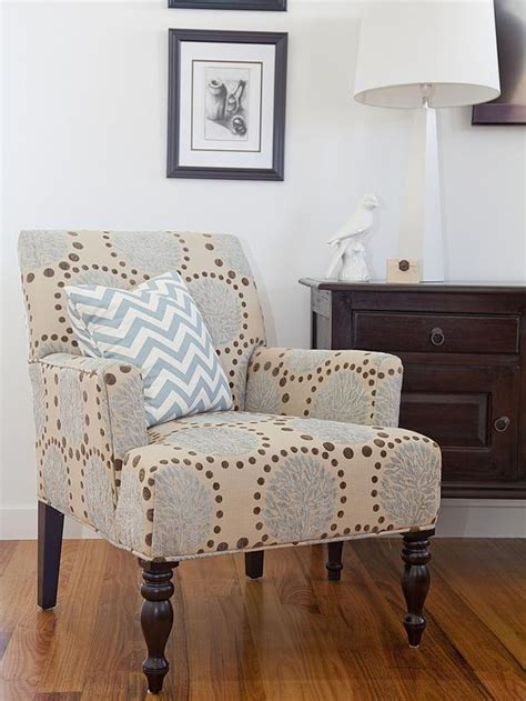 fabric chairs for living room neutral living room chair with blue and brown pattern hgtv