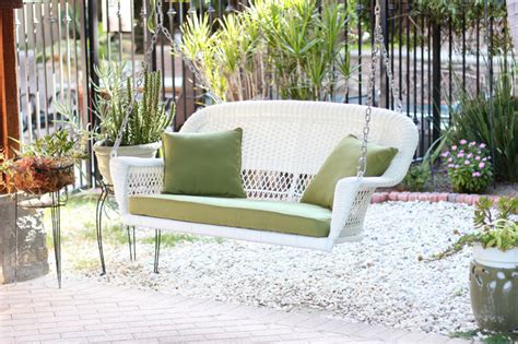white wicker porch swing white resin wicker porch swing with cushions