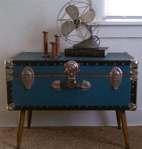 Black Trunk Coffee Table Low Stand Fan On Steamer Trunk Coffee Table In Bedroom With Beige Carpeting Wicker Trunk Coffee