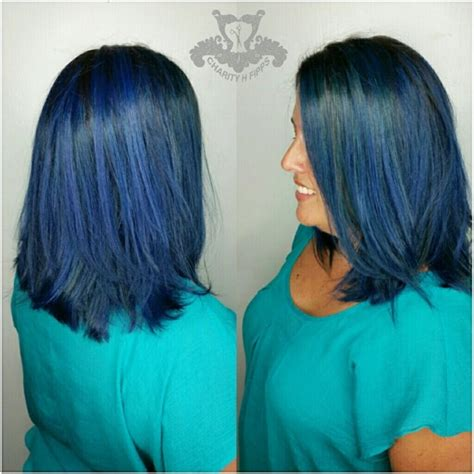 swing bob haircut steps rich sapphire blue tones long swing bob haircut