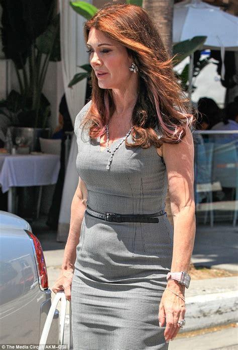 lisa vanderpump pink top with black bow lisa vanderpump is all business in slinky dress and heavy