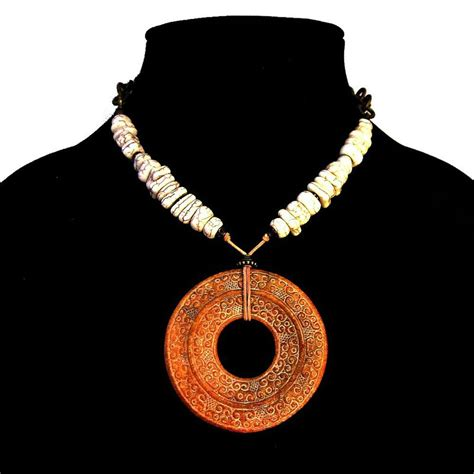carved jade donut pendant necklace with white
