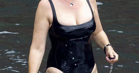 jamie lee curtis now jamie lee curtis wears low cut black swimsuit at age 54