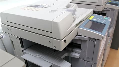 Office Copy Machines by Office Using Paper Copy Machine Hd Stock Clip