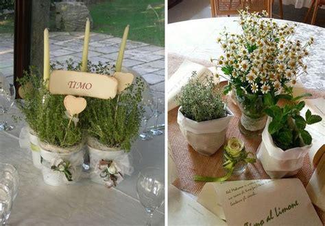 composizioni di candele centrotavola di matrimonio con candele e fiori idee per