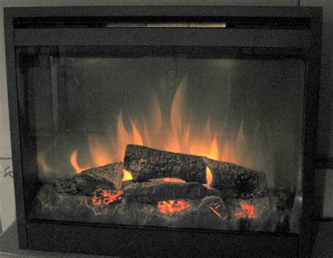 dimplex 26in electric fireplace insert with trim on