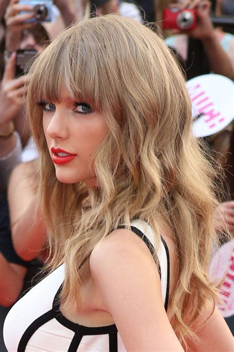 what colours does taylor swift use for ash blonde hair taylor swift wavy ash blonde choppy layers straight bangs