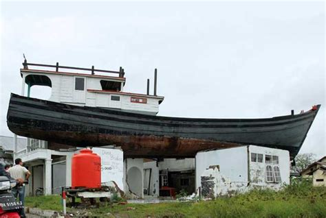 boat on the roof aceh tsunami 10 years before and after in aceh caritas