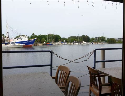 boat rs near tarpon springs fl table side view of the fishing boats in the channel behind