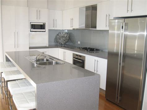 kitchen grey white waterfall bench top with grey cupboards kitchens and