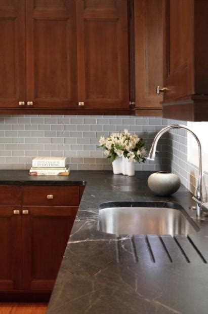 Light Soapstone - soapstone countertops were routed out for drainage faucet