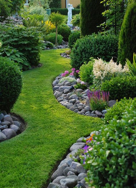 looking garden edging river rocks used along