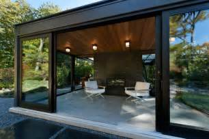 Prefabricated Outdoor Fireplace - glass house in the garden modern patio boston by flavin architects