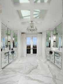167 mirrored vanity cabinets white carrara marble floors and a chandelier all add to the sparkle