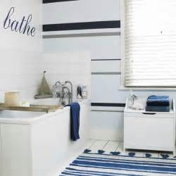 New striped feature wall creates interest in this bathoom and the