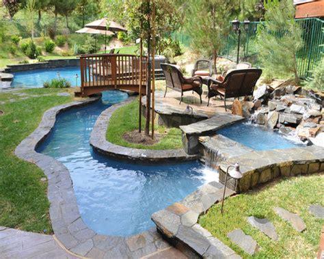 tropical backyard  lazy river pool home design ideas