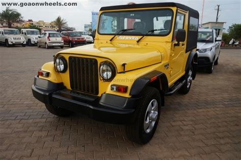 one customised mahindra thar in yellow color offered in goa
