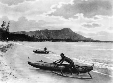 canoes waikiki file two natives with outrigger canoes at shoreline