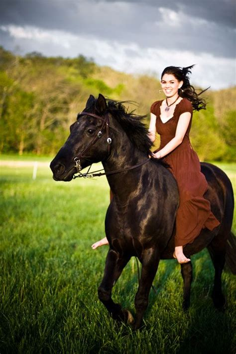 commercial girl riding horse girl in dress riding horse bareback in pasture