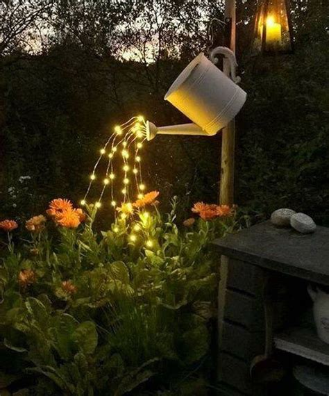watering can with lights glowing watering can with fairy lights total survival