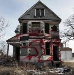 detroit homes for blighted home that says detroit is going bankrupt
