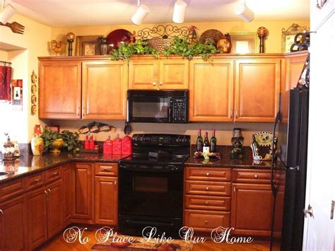 decorating ideas for kitchen cabinets pin by terrie krupitzer on decorating the top of kitchen