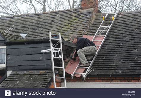 ladder on a roof roofing ladders a pair of aluminium ladder staging