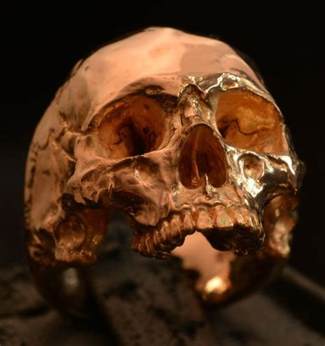 gold skull into the jewelry 18 kt gold skull ring mid