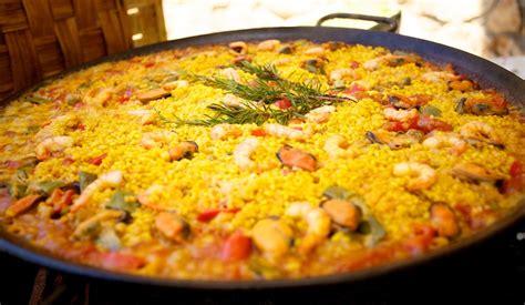 Green Main Dish - paella the traditional spanish dish from valencia linguaschools com blog