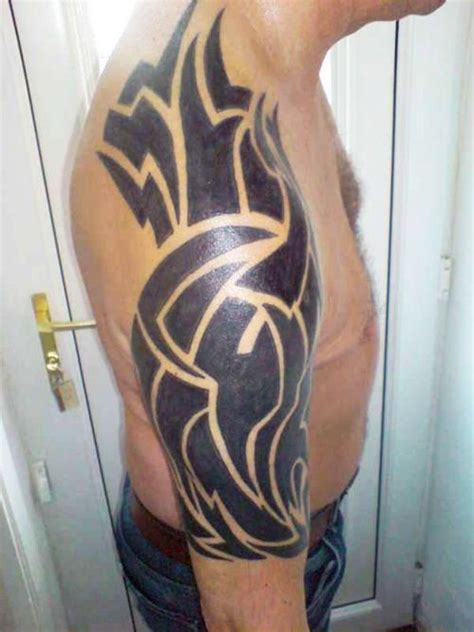 getting a tribal tattoo getting forearm tattoos for will make your arm look