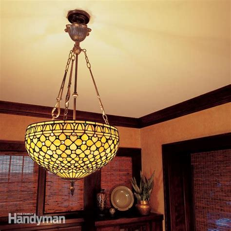 how to hang a ceiling light how to hang a ceiling light fixture family handyman