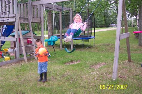 a child swings on a playground swing children s playground has a fort with swings even a quot baby