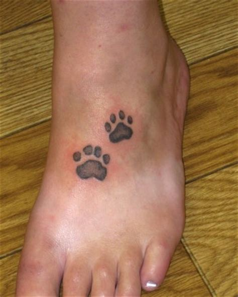 paw print with name foot realistic paw prints on a foot tattoos