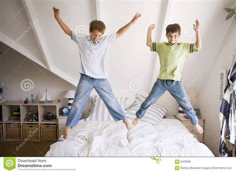young girl jumping   bed royalty  stock image