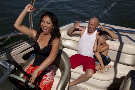 boat licence drink driving happy woman driving boat scared boys stock photo