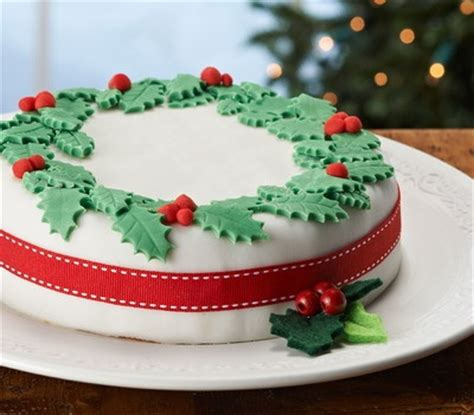 this christmas wreath cake is covered with fondant and