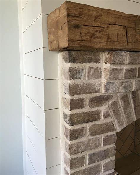 shiplap over brick whitewashed brick rustic wood mantel shiplap farmhouse