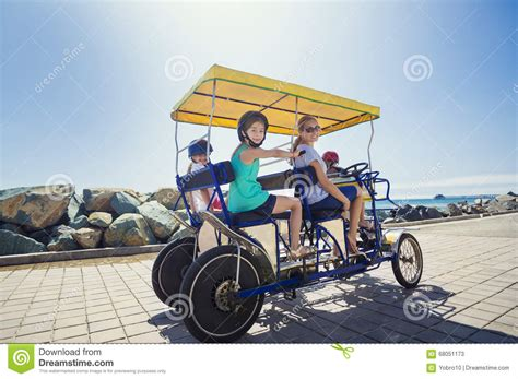 pedal boat yellow family on pedal boat with yellow slide in sea royalty free