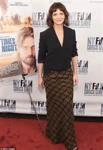 Juliette Binoche looks youthful and stylish at film