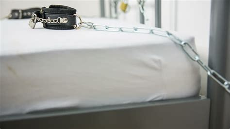 dominant in bed dominance in bed pad lock with chain on bed with leather collar