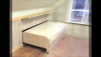 Ikea Bed Storage Hack paneling the end of the hidden pull out knee wall bed