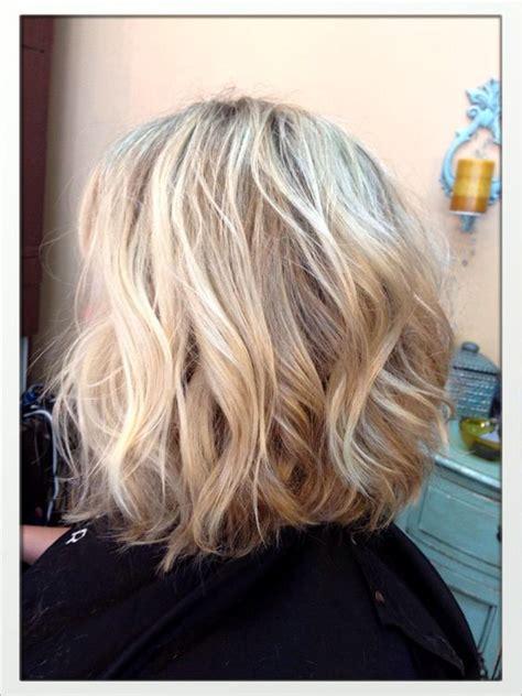 slightly angled long bob blonde shoulder length slightly inverted bob hair