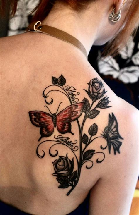 butterfly tattoo on girl s shoulder black roses and butterfly tattoo on girl right back shoulder