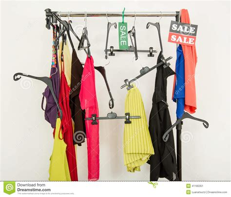 rack of clothes and hangers after a big sale stock